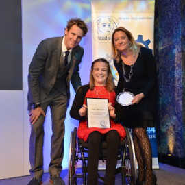 Sarah Whitchurch collects her award from James Cracknell and a representative of award sponsor Slater & Gordon Lawyers