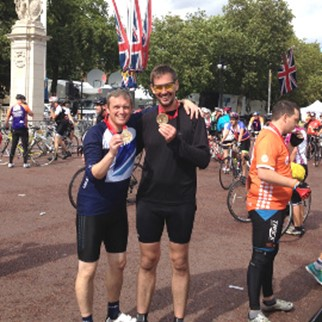 Headway Heroes Simon Cotterill and Dave Cole celebrate completing the RideLondon-Surrey 100