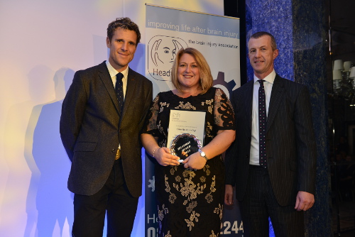 Charlie Korving (centre) collects her award