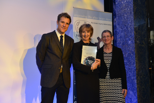 Gill Leandro (centre) collects her award