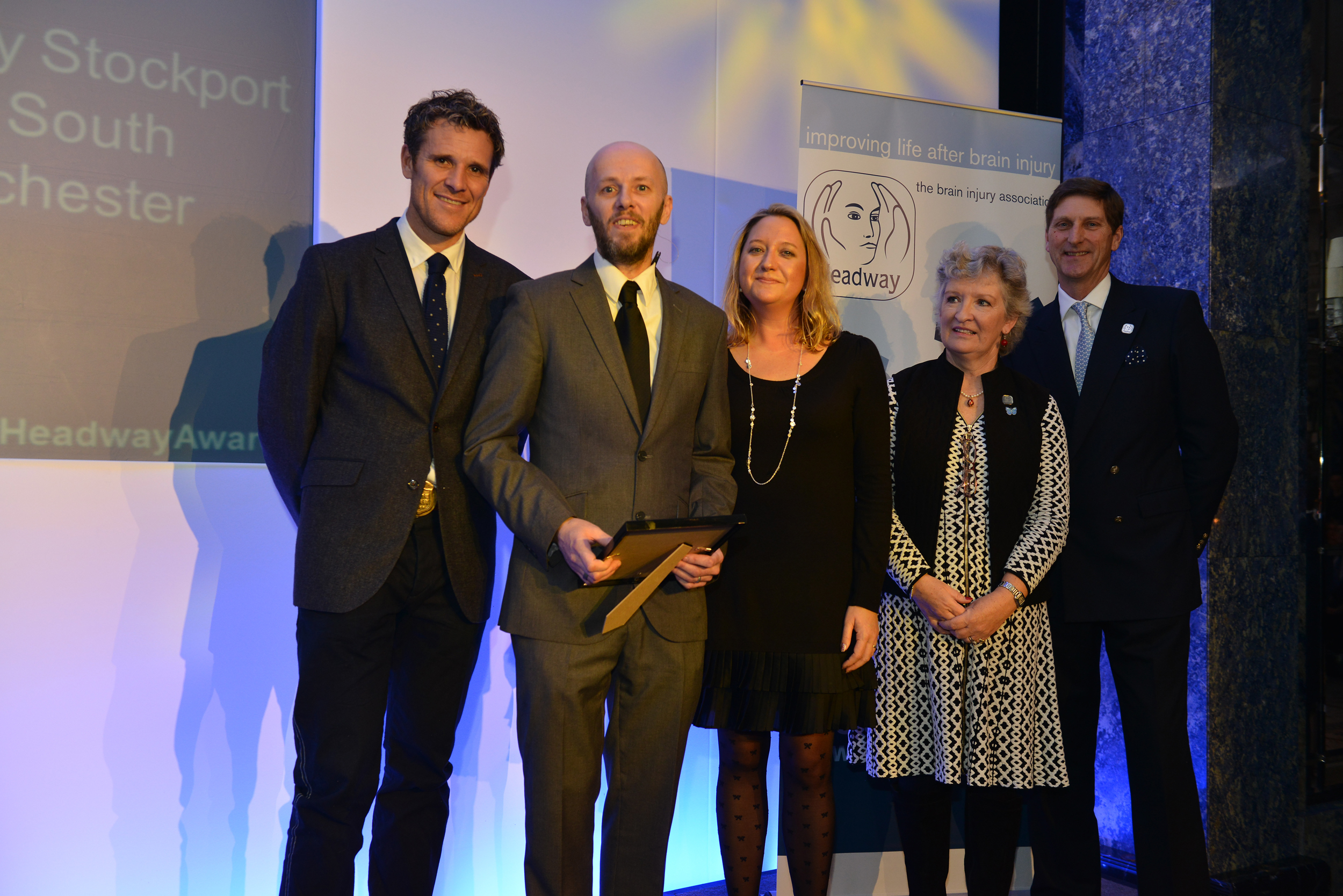 Steven Lomas (second from left) collects his award
