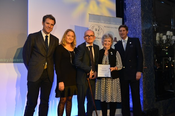 Jeff Mayle (centre) receiving his Headway Achiever of the Year Award at the Dorchester Hotel in 2015
