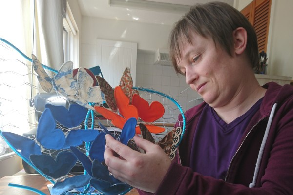 Kerry Jeffs works on her art