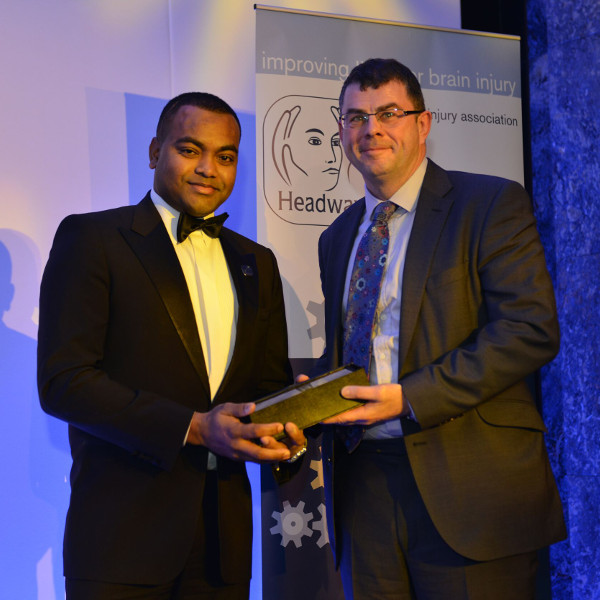 Chris Ronan accepts the Headway Challenge Baton from Johnson Beharry VC
