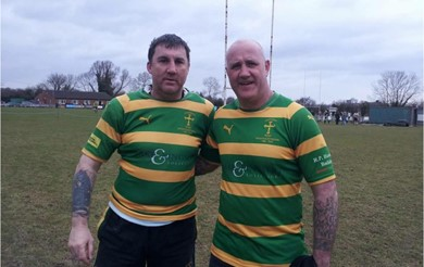 Mike Palmer (left) in green and yellow striped kit on the rugby field