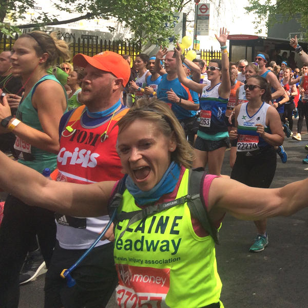 Elaine Murray cheers at the camera as she takes on the London Marathon for Headway