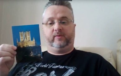Andy Nicholson holds up a postcard in his 'Holiday from brain injury' video