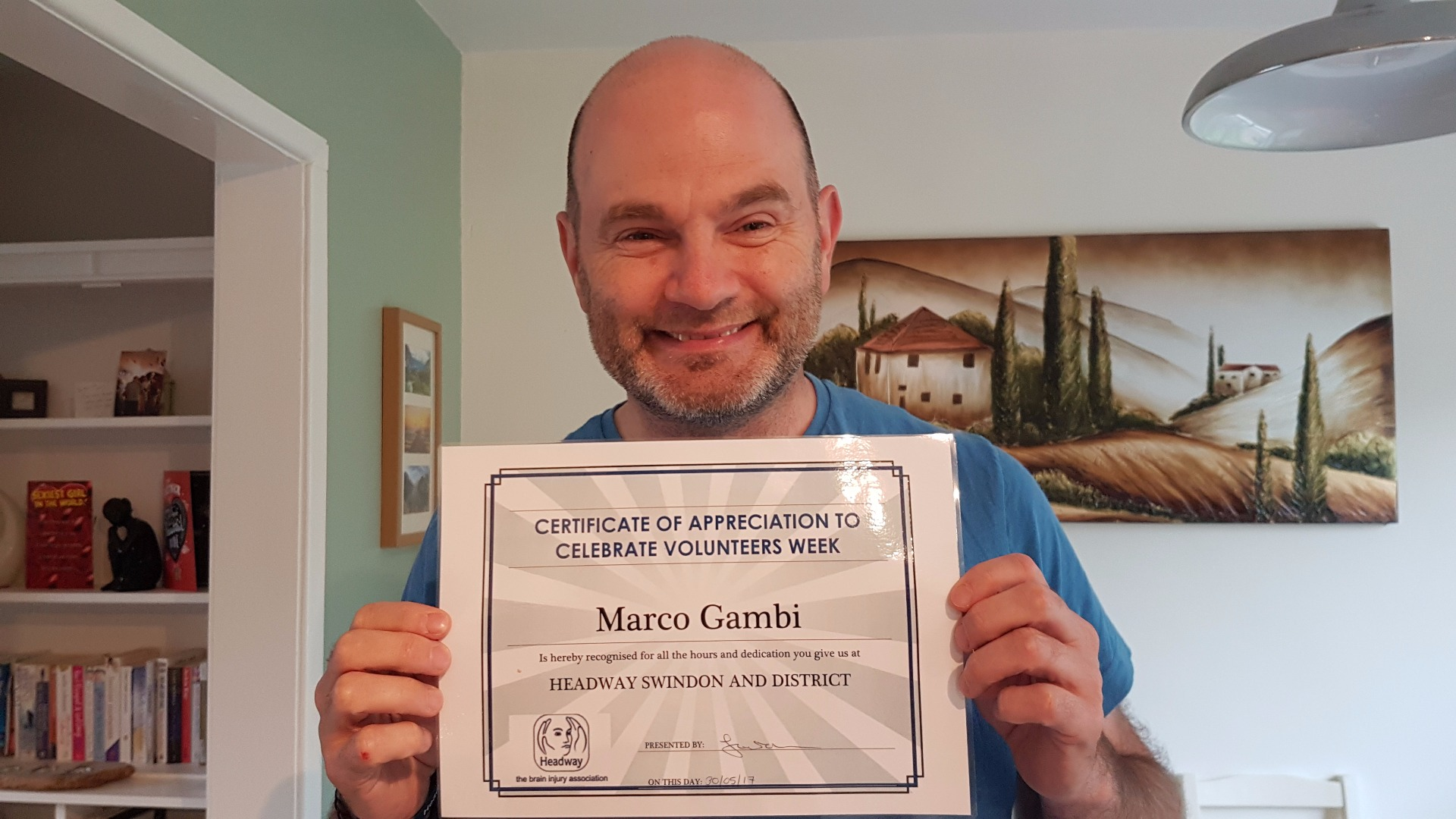 Marco was awarded for his volunteering with Headway Swindon