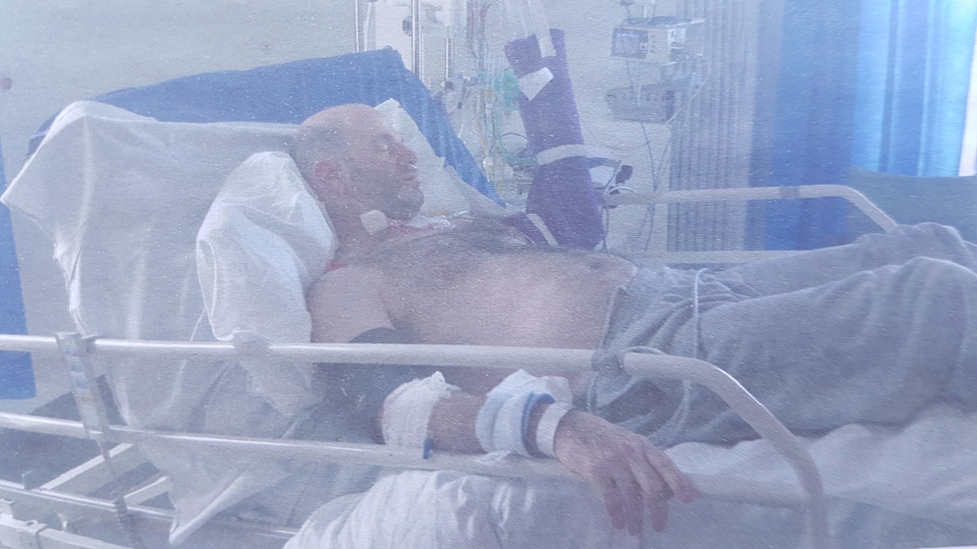 Marco in his hospital bed following the crash