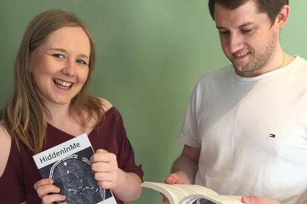 Becky Cobb and Simon Commins with their book HiddenInMe, about life after stroke