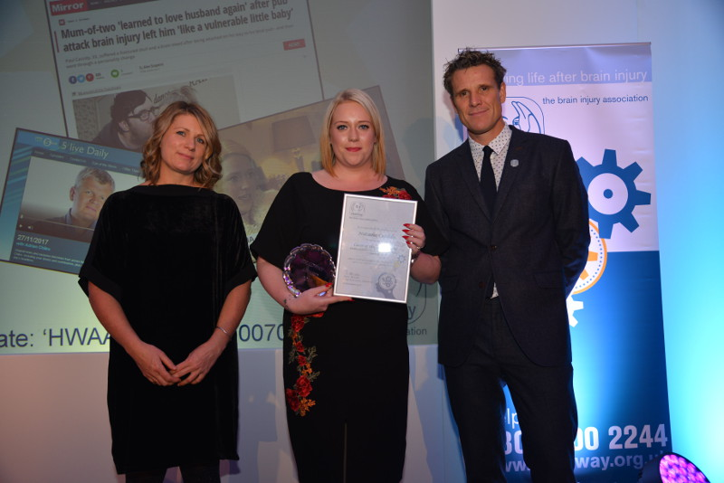 Natasha Cassidy collects her Headway Carer of the Year Award