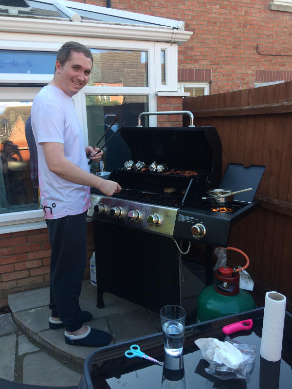 Eventually, Daniel was able to relearn skills like cooking. Here, he takes on his first barbecue!