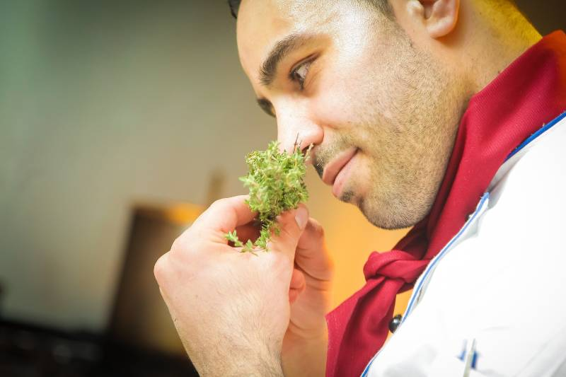chef smelling herbs