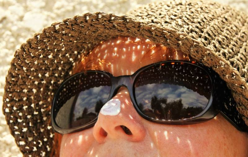 lady with sunscreen on her nose